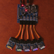 BridgeX5 Shown Displaying Numbers on Different Colors of AS1115 Mini Modules